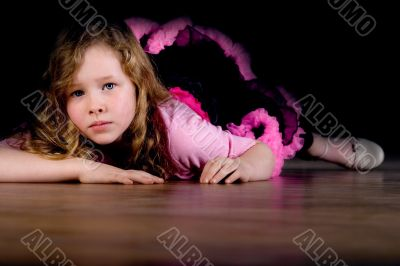 Ballet girl is laying down