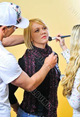 Studio Assistants working on a Model