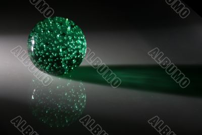 A green sphere with reflection