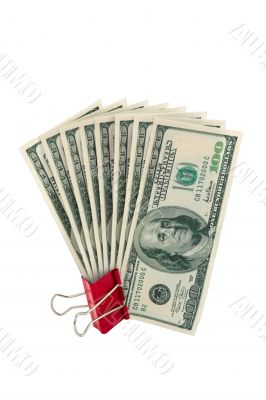 Dollars in red binder isolated on white background