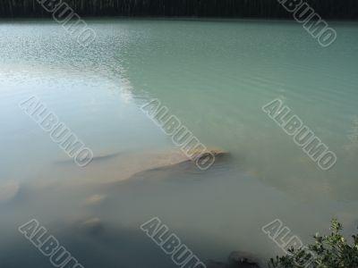 green lake and rocks