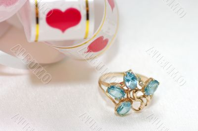 golden ring with blue topaz