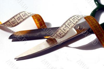 Scissors and a mesuring tape