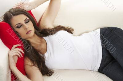 woman with red pillow in bed