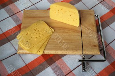 portion cheese on a wooden desk