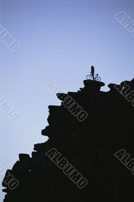 Mountain Biker Atop Cliff in Colorado