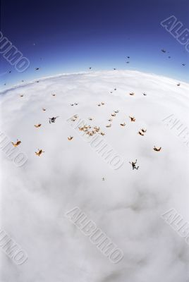 Skydiving Formation Above the Clouds