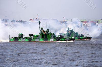 Military ship is shooting