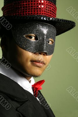 Masked performer portrait with top hat