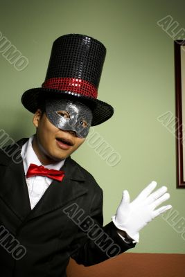 Man in mask and top hat surprise