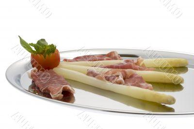 asparagus with parma hams on silver tray