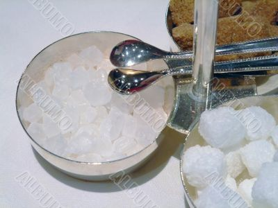 Candy sugar cubes with tongs