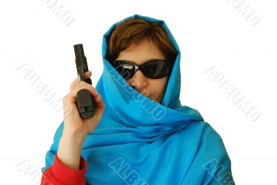 woman in east clothes holds handgun