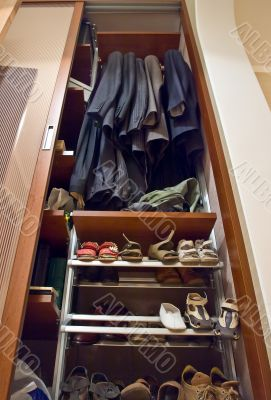Home wardrobe with suits and shoes