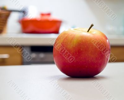Rich apple on the kitchen desk