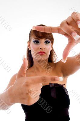 smiling glamorous female showing framing gesture