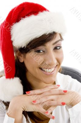 smiling female accountant in christmas hat