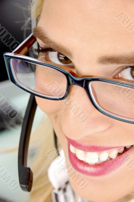 close view of smiling customer care provider