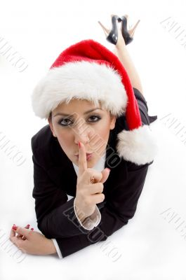 businesswoman with christmas hat instructing