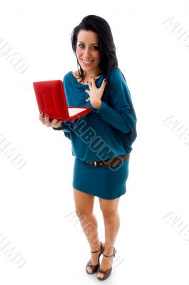 pleased woman with box on white background