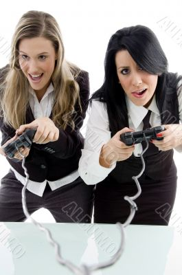 female partners playing game and holding remote