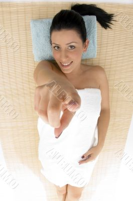 pointing woman going to take massage