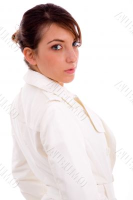 side view of fashionable female looking at camera