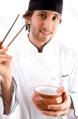 young chef with chopsticks and bowl