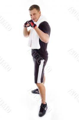 standing adult man showing fists