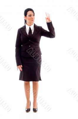 standing lawyer showing counting hand gesture