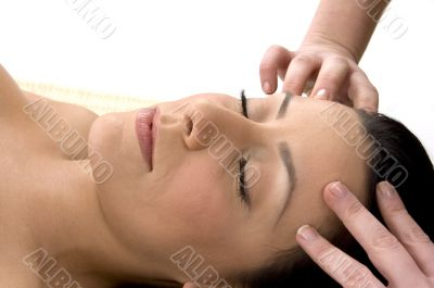 front view of female taking head massage