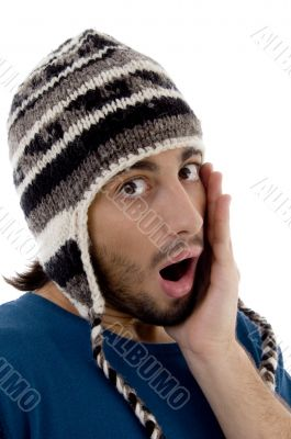 shocked young man wearing winter hat