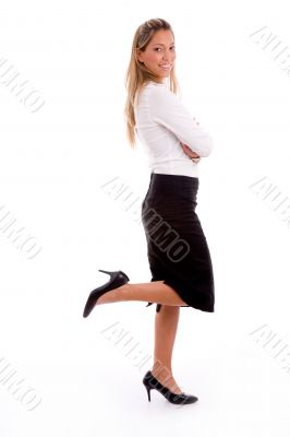 side view of smiling ceo with crossed arms