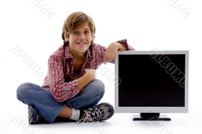 front view of sitting boy with lcd screen