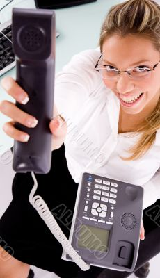 smiling employee showing phone receiver
