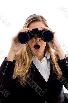 young woman eyeing with binoculars