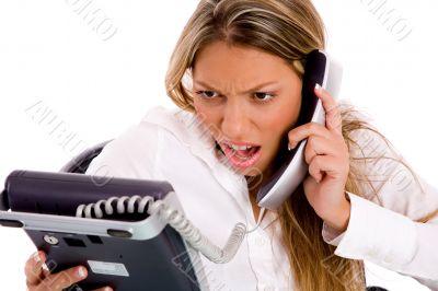 portrait of surprised businesswoman holding phone