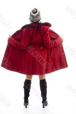 full body pose of american woman in overcoat