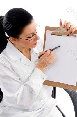 female doctor indicating writing pad