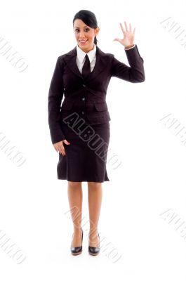 young businesswoman showing counting hand gesture