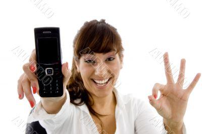 smiling female executive holding mobile