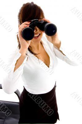 businesswoman looking through binocular