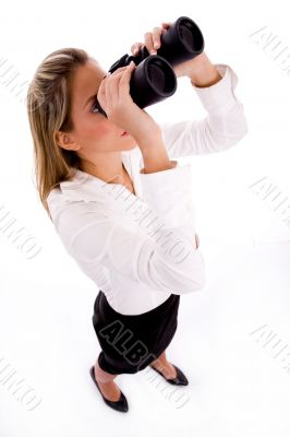 businesswoman looking through binocular