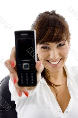 smiling businesswoman showing her cell phone