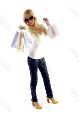 front view of glad female with shopping bags