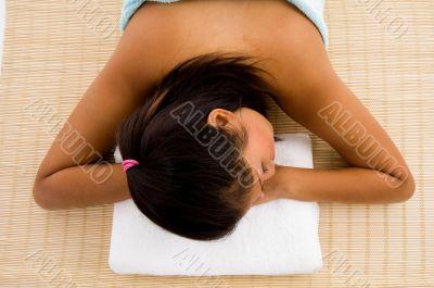 resting beautiful adult woman in towel