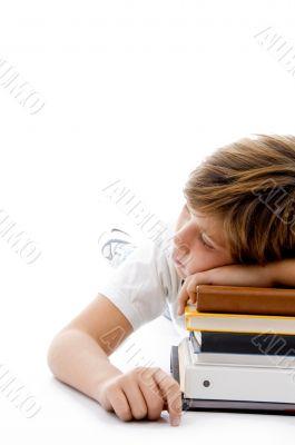 half length view of boy sleeping on books
