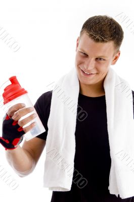 smiling muscular man with water bottle