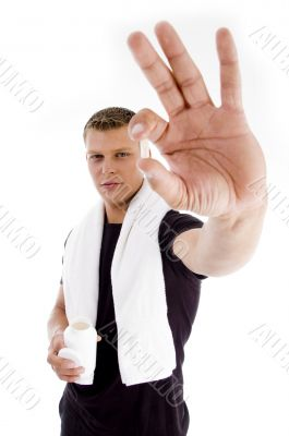 muscular male holding medicine