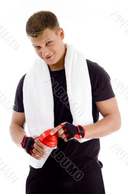 muscular male opening the cap of water bottle